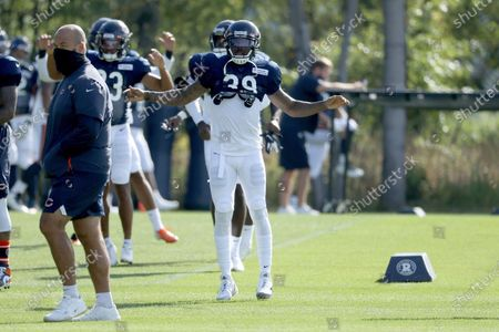 Chicago Bears' Eddie Jackson (39) warms up during NFL football training camp at Halas Hall, in Lake Forest, Ill