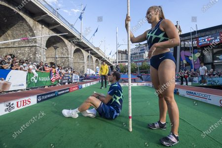 Renaud Lavillenie of France, left, and Angelica Moser of Switzerland, right, wait their turn, during the pole vault city event of the Athletissima IAAF Diamond League international athletics meeting, in Lausanne, Switzerland, Wednesday, September 2, 2020. Due to the pandemic of the coronavirus disease (COVID-19), this year's Athletissima meeting organize only the so-called 'City Event', an edition of Athletissima reserved exclusively for pole vault organised in the city centre and in front of 1000 spectators.