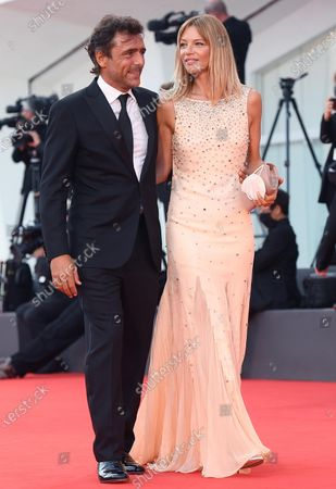 Adriano Giannini (L) and his wife Gaia Trussardi arrive for the opening ceremony and screening of 'Lacci' at the 77th annual Venice International Film Festival, in Venice, Italy, 02 September 2020.The event is the first major in-person film fest to be held in the wake of the Covid-19 coronavirus pandemic. Attendees have to follow strict safety measures like mandatory face masks indoors, temperature scanners, and socially distanced screenings to reduce the risk of infection. The public is barred from the red carpet, and big stars are expected to be largely absent this year. The 77th edition of the festival runs from 02 to 12 September 2020.