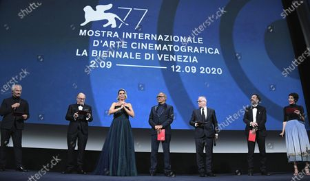 Anna Foglietta (3-L) on stage with The European Festival Directors : Jose' Luis Rebordinos (San Sebastian International Film Festival), Vanja Kaludjercic (International Film Festival Rotterdam), Alberto Barbera (Venice Film Festival), Thierry Fremaux (Festival de Cannes), Karel Och (Karlovy Vary International Film Festival) and Lili Hinstin (Locarno Film Festival), during the opening ceremony and screening of 'Lacci (The Ties)' at the 77th annual Venice International Film Festival, in Venice Italy, 02 September 2020. The event is the first major in-person film fest to be held in the wake of the Covid-19 coronavirus pandemic. Attendees have to follow strict safety measures like mandatory face masks indoors, temperature scanners, and socially distanced screenings to reduce the risk of infection. The public is barred from the red carpet, and big stars are expected to be largely absent this year. The 77th edition of the festival runs from 02 to 12 September 2020.