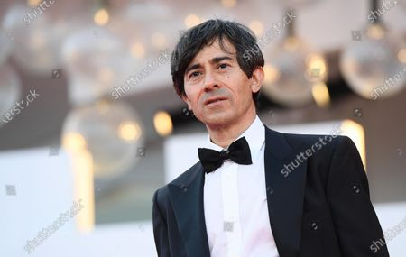 Luigi Lo Cascio arrives for the opening ceremony and screening of 'Lacci' at the 77th annual Venice International Film Festival, in Venice, Italy, 02 September 2020. The event is the first major in-person film fest to be held in the wake of the Covid-19 coronavirus pandemic. Attendees have to follow strict safety measures like mandatory face masks indoors, temperature scanners, and socially distanced screenings to reduce the risk of infection. The public is barred from the red carpet, and big stars are expected to be largely absent this year. The 77th edition of the festival runs from 02 to 12 September 2020.