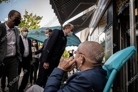 French Justice Minister Eric Dupond-Moretti (C), accompanied by Dijon mayor Francois Rebsamen (2ndL), visits the Gresilles district in Dijon, France, 02 September 2020.