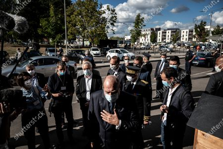 French Justice Minister Eric Dupond-Moretti (C), accompanied by Dijon mayor Francois Rebsamen (4thL), visits the Gresilles district in Dijon, France, 02 September 2020.