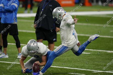Detroit Lions place kicker Matt Prater kicks a field goal as Jack Fox handles the ball placement during drills at the Lions NFL football practice, in Detroit