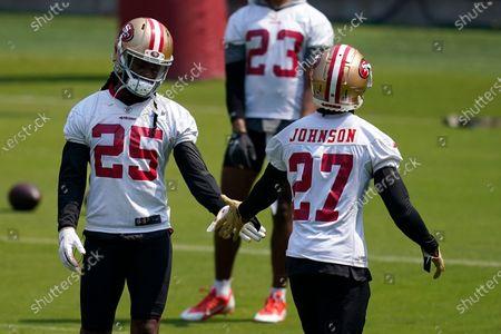 San Francisco 49ers defensive back Richard Sherman (25) greets Dontae Johnson during NFL football practice in Santa Clara, Calif