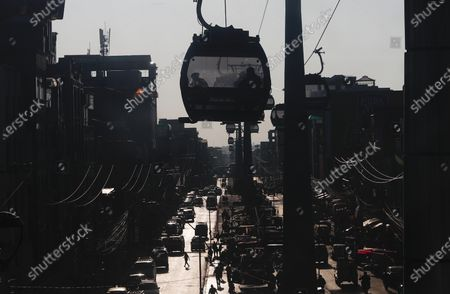People ride in one of the cable cars that interconnects the city of La Paz and El Alto, Bolivia
