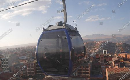 Person rides in one of the cable cars that interconnects the city of El Alto and La Paz, Bolivia