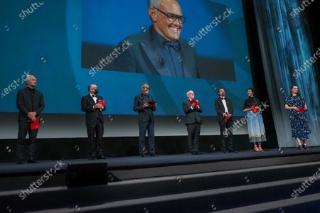 (L-R) Karel Och, Jose Luis Rebordinos, Director of the Venice Film Festival Alberto Barbera, Director of Cannes Film Festival Thierry Fremaux, Carlo Chatrian, Lili Hinstin and Vanja Kaludjercic attend the Opening Ceremony during the 77th Venice Film Festival at on September 02, 2020 in Venice, Italy.