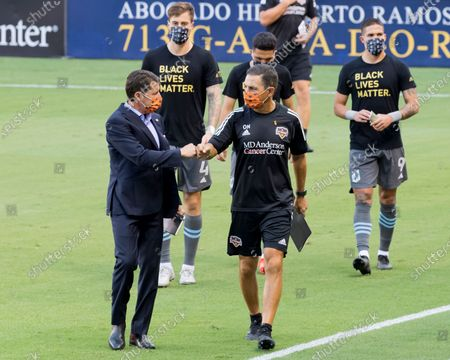 Houston Dynamo head coach Tab Ramos enters the pitch with support staff prior to the match against the Minnesota United at BBVA Stadium in Houston, Texas. Maria Lysaker / CSM