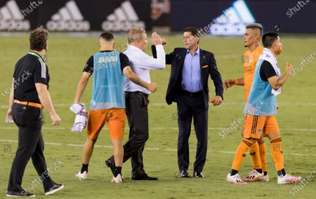 Minnesota United head coach Adrian Heath and Houston Dynamo head coach Tab Ramos on the pitch post match at BBVA Stadium in Houston, Texas. Maria Lysaker / CSM