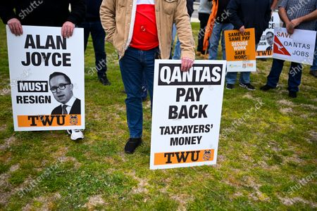 Qantas employees hold signs during a rally organised by the Transport Workers Union (TWU) outside Parliament in Canberra, Australia, 03 September 2020. Qantas has announced that it will slash over 2400 jobs, prompting unions to call on the federal government to intervene