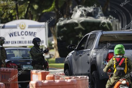 Soldiers secure the gates of Camp Aguinaldo military headquarters where U.S. Marine Lance Cpl. Joseph Scott Pemberton is held in Quezon city, Philippines, . A Philippine court has ordered the early release for good conduct for Pemberton who was convicted in the 2014 killing of transgender Filipino Jennifer Laude which sparked anger in the former American colony