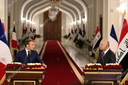 French President Emmanuel Macron (L) and Iraqi President Barham Salih attend a joint press conference in Baghdad, Iraq, on Sept. 2, 2020. Iraqi President Barham Salih on Wednesday met with his French counterpart Emmanuel Macron in Baghdad to discuss bilateral ties and the war against the Islamic State (IS) group.