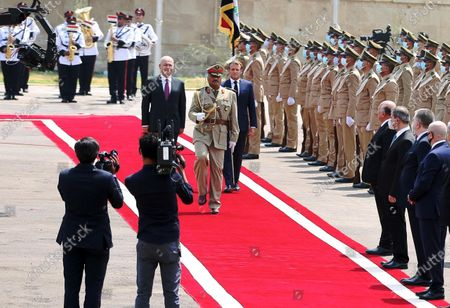 Iraqi President Barham Salih (C-L) and French President Emmanuel Macron (C-R) review a guard of honor in Baghdad, Iraq, on Sept. 2, 2020. Iraqi President Barham Salih on Wednesday met with his French counterpart Emmanuel Macron in Baghdad to discuss bilateral ties and the war against the Islamic State (IS) group.