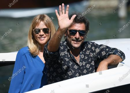 Stock Picture of Adriano Giannini and his wife Gaia Trussardi (L) leave Lido Beach during the 77th annual Venice International Film Festival, in Venice, Italy, 03 September 2020. The event is the first major in-person film fest to be held in the wake of the Covid-19 coronavirus pandemic. The 77th edition of the festival runs from 02 to 12 September 2020.
