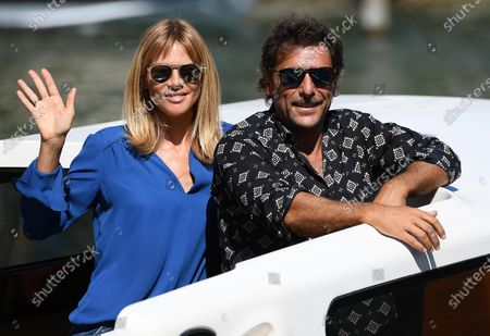 Adriano Giannini and his wife Gaia Trussardi (L) leave Lido Beach during the 77th annual Venice International Film Festival, in Venice, Italy, 03 September 2020. The event is the first major in-person film fest to be held in the wake of the Covid-19 coronavirus pandemic. The 77th edition of the festival runs from 02 to 12 September 2020.