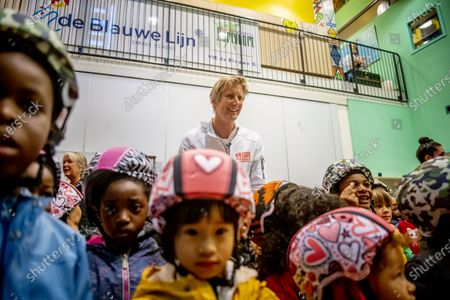 Edwin van der Sar hands out bicycle helmets to pupils of the Blue Line Primary School as part of the Safe cycling to school project, a project set up by the Edwin van der Sar Foundation and the ANWB to reduce the number of road casualties.