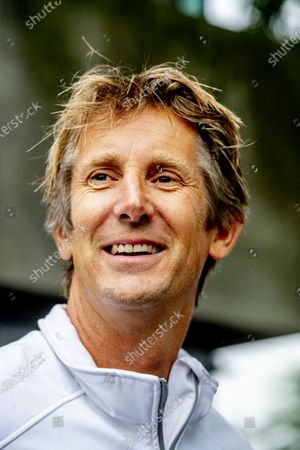 Stock Photo of Edwin van der Sar hands out bicycle helmets to pupils of the Blue Line Primary School as part of the Safe cycling to school project, a project set up by the Edwin van der Sar Foundation and the ANWB to reduce the number of road casualties.