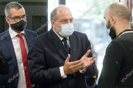 Stock Image of Relocation of Minister of Justice Eric Dupond-Moretti to the Gresilles district in Dijon. Discussions with an optician in the presence of the mayor of Dijon Francois Rebsamen, the prefect and the public prosecutor.