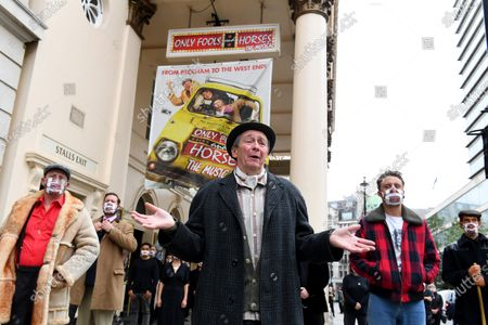 Paul Whitehouse and other members of the cast and crew of Only Fools and Horses The Musical at the Theatre Royal Haymarket after making a 15 minute socially-distanced silent stand to show solidarity with those in the UK theatre industry who have lost their jobs and received no government support, highlight the lack of government guidance for the reopening of theatres, and to implore the Government to provide the industry with a date when theatres can reopen without social distancing.