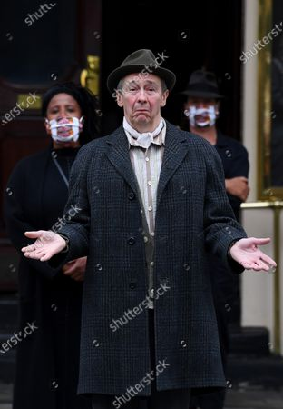 Stock Photo of Paul Whitehouse and other members of the cast and crew of Only Fools and Horses The Musical at the Theatre Royal Haymarket after making a 15 minute socially-distanced silent stand to show solidarity with those in the UK theatre industry who have lost their jobs and received no government support, highlight the lack of government guidance for the reopening of theatres, and to implore the Government to provide the industry with a date when theatres can reopen without social distancing.