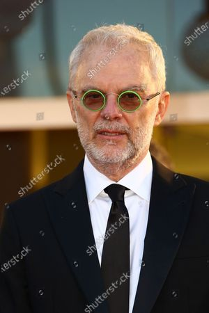 Daniele Luchetti poses for photographers upon arrival at the opening ceremony of the 77th edition of the Venice Film Festival in Venice, Italy