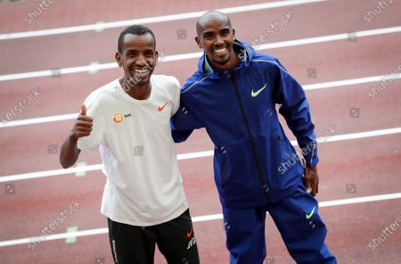 Bashir Abdi (L) of Belgium and Mo Farah (R) of Britain pose for photographers after a press conference of the IAAF Diamond League Memorial Van Damme athletics meeting in Brussels, Belgium, 03 September 2020. The Memorial Van Damme exhibition event will take place on 04 September 2020.