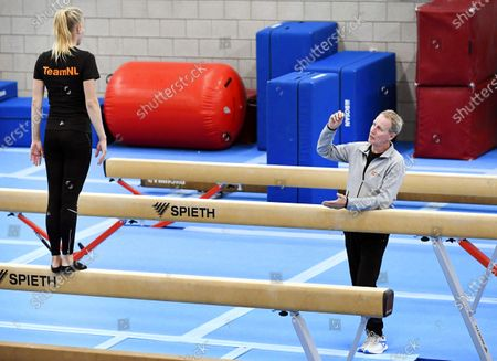 Stock Photo of Dutch national gymnastics team coach Vincent Wevers (R) and his daughter Lieke Wevers (L) train in the SportQube sports hall in Nijmegen, Netherlands, 03 September 2020. The Dutch gymnastics association has decided to resume the women's top sport program under certain conditions after coaches Vincent Wevers and Gerben Wiersma were put on non-active after the many testimonials about mental and physical abuse in women's gymnastics.