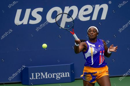 Stock Image of Sloane Stephens, of the United States, returns a shot to Olga Govortsova, of Belarus, during the second round of the US Open tennis championships, in New York
