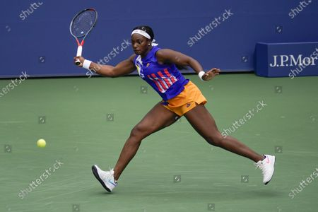 Stock Photo of Sloane Stephens, of the United States, returns a shot to Olga Govortsova, of Belarus, during the second round of the US Open tennis championships, in New York