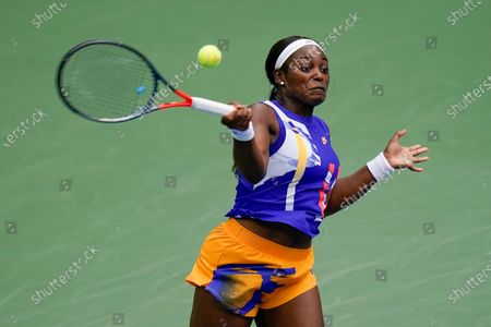 Sloane Stephens, of the United States, returns a shot to Olga Govortsova, of Belarus, during the second round of the US Open tennis championships, in New York
