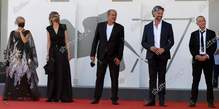 Stock Photo of Serbian actress/cast member Jasna Duricic, Bosnian filmmaker Jasmila Zbanic, Serbian actor/cast member Boris Isakovic, Belgian actor/cast member Johan Heldenbergh and Dutch actor/cast member Raymond Thiry arrive for the premiere of 'Quo Vadis, Aida?' during the 77th Venice Film Festival in Venice, Italy, 03 September 2020. The event is the first major in-person film fest to be held in the wake of the Covid-19 coronavirus pandemic. Attendees have to follow strict safety measures like mandatory face masks indoors, temperature scanners, and socially distanced screenings to reduce the risk of infection. The public is barred from the red carpet, and big stars are expected to be largely absent this year. The 77th edition of the festival runs from 02 to 12 September 2020.
