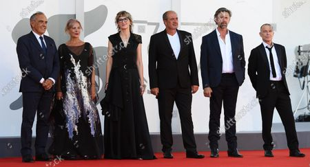 Film Festival Director Alberto Barbera, Serbian actress/cast member Jasna Duricic, Bosnian filmmaker Jasmila Zbanic, Serbian actor/cast member Boris Isakovic, Belgian actor/cast member Johan Heldenbergh and Dutch actor/cast member Raymond Thiry arrive for the premiere of 'Quo Vadis, Aida?' during the 77th Venice Film Festival in Venice, Italy, 03 September 2020. The event is the first major in-person film fest to be held in the wake of the Covid-19 coronavirus pandemic. Attendees have to follow strict safety measures like mandatory face masks indoors, temperature scanners, and socially distanced screenings to reduce the risk of infection. The public is barred from the red carpet, and big stars are expected to be largely absent this year. The 77th edition of the festival runs from 02 to 12 September 2020.