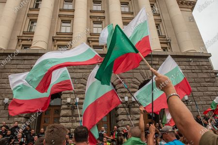 Protesters waving flags during the demonstration. For the 56th consecutive day, Bulgarians have gathered outside government buildings accusing the Prime Minister, Boyko Borisov of corruption and protecting powerful tycoons. Demonstrators in the capital and cities across the country are calling for the resignation of the Prime Minister and his centre-right government.