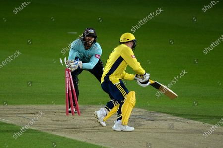 Ben Foakes of Surrey takes of the bails as he stumps Tom Alsop