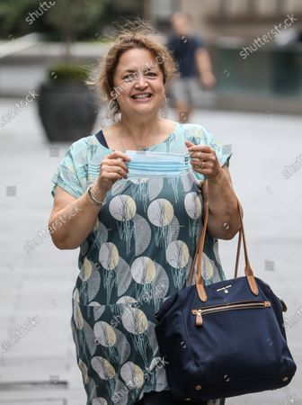Ruth Jones seen about to wear a facemask while departing from the Global Radio studios in London.