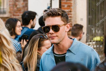 Actor Jeremy Irvine wearing Salvatore Ferragamo sunglasses, blue knitted jacket, seen outside Salvatore Ferragamo show during Milan Fashion Week Womenswear Spring Summer 2020