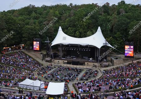 A general view prior to the beginning of a concert by German Singer Roland Kaiser (not in the picture) at the 'Waldbuehne' (lit.: Forest Stage) in Berlin, Germany, 03 September 2020. German Singer Roland Kaiser performs in a first open air concert after clubs and event halls were closed due to the ongoing coronavirus pandemic. A maximum amount of 5.000 people are allowed inside the Waldbuehne auditorium, where usually some 22.000 spectators can follow concerts and other events.