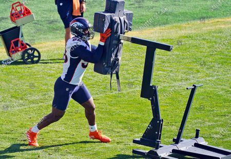 Stock Photo of Denver Broncos linebacker Von Miller takes part in drills during an NFL football practice, in Englewood, Colo