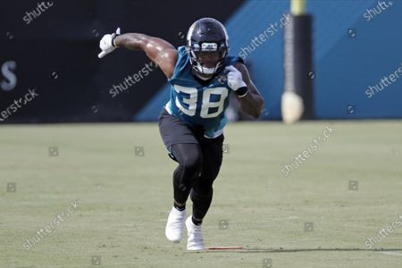 Stock Image of Jacksonville Jaguars running back James Robinson (38) performs a drill during an NFL football workout, in Jacksonville, Fla. s stunning as Leonard Fournette's departure was from Jacksonville, his replacement might be equally surprising. Jacksonville expects to split the bulk of the work between second-year pro Devine Ozigbo and undrafted rookie James Robinson