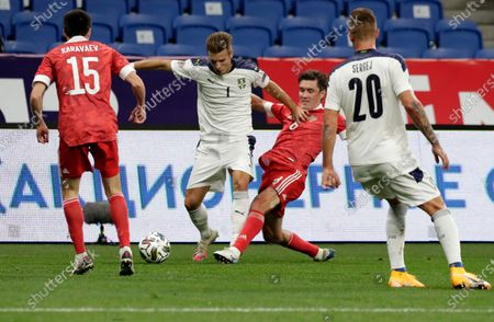 Serbia's Darko Lazovic, second left, duels for the ball with Russia's Yuri Zhirkov, second right, during the UEFA Nations League soccer match between Russia and Serbia at the VTB Arena, in Moscow, Russia