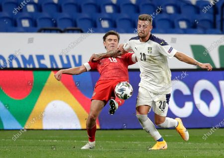 Serbia's Sergej Milinkovic-Savic, right, duels for the ball with Russia's Yuri Zhirkov during the UEFA Nations League soccer match between Russia and Serbia at the VTB Arena, in Moscow, Russia