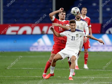Serbia's Filip Djuricic, right, duels for the ball with Russia's Roman Zobnin during the UEFA Nations League soccer match between Russia and Serbia at the VTB Arena, in Moscow, Russia