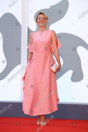Jury member Ludivine Sagnier poses for photographers upon arrival at the premiere of the film 'Amants (Lovers)' during the 77th edition of the Venice Film Festival in Venice, Italy