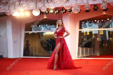 Madalina Ghenea poses for photographers upon arrival at the premiere of the film 'Amants (Lovers)' during the 77th edition of the Venice Film Festival in Venice, Italy
