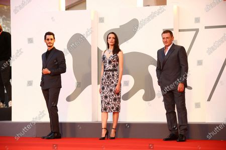 Pierre Niney, Stacy Martin and Benoit Magimel pose for photographers upon arrival at the premiere of the film 'Amants (Lovers)' during the 77th edition of the Venice Film Festival in Venice, Italy