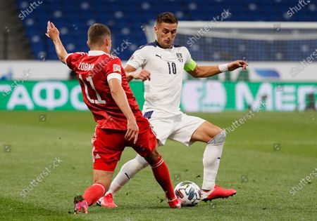Roman Zobnin (L) of Russia in action against Dusan Tadic (R) of Serbia during the UEFA Nations League Group stage match between Russian and Serbia in Moscow, Russia, 03 September 2020.