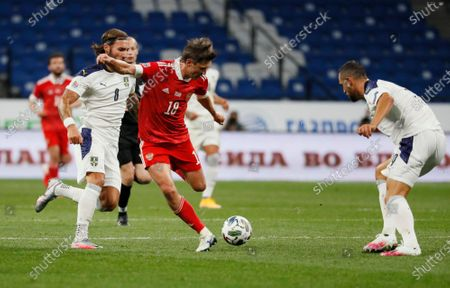 Yuri Zhirkov (C) of Russia in action against Nemanja Gudelj (L) and Nikola Maksimovic (R) of Serbia during the UEFA Nations League Group stage match between Russian and Serbia in Moscow, Russia, 03 September 2020.