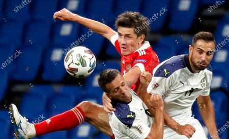 Yuri Zhirkov (C) of Russia in action against Nemanja Maksimovic (L) and Nikola Maksimovic (R) of Serbia during the UEFA Nations League Group stage match between Russian and Serbia in Moscow, Russia, 03 September 2020.