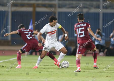 Stock Photo of Zamalek  player Youssef Ibrahim Obama (C)  in action against Pyramids  player  Mahmoud Hamada (R)  and Mohamed Hamdy (L) during the Egyptian Premier League soccer match between Zamalek and Pyramids at 30 June Stadium in Cairo, Egypt, 03 September  2020.